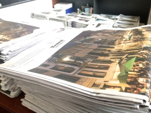 Stacks of papers for distribution among reporters.